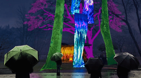 "Do we need some color and light in our lives these days? Oh yes, we do. The Portland Winter Light Festival heeds the call – this year as a dispersed ""non-festival"" to – allow plenty of social distancing. Come experience Mayer/Reed's installation in the grove at Oaks Park. We're painting with a bigger brush, utilizing the 80 ft tall trees as a canvas. Within this arboreal canopy of color, illuminated mylar curtains reflect a kaleidoscope of moving color, picking up accents from amusement surroundings like the aurora borealis. Down on the ground, we'll stoke a glowing fire pit in a historic picnic shelter to warm visitors. We thank our partner, Oaks Park, for welcoming this free display amid its stalwart oak trees. Come visit the Kaleidoscopic Canopy at Oaks Park this weekend and next, 6 to 10 pm, February 5-6 and 12-13. And check the map to find all kinds of other dazzling light exhibits throughout the city. See you from a distance!"